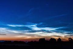 NOCTILUCENT DARK BLUE CLOUDS FAST MOVING IN HORIZON WITH BEAUTIFUL SKY. Silvery clouds Noctilucent Clouds , a rare sky. NOCTILUCENT DARK BLUE CLOUDS FAST MOVING stock footage