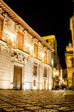 Nocturnal brights. Long exposure picture of a stone street taken at night close to an old palace Royalty Free Stock Photos