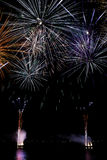 Nocturnal celebration with colorful fireworks Royalty Free Stock Photo
