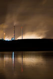 Nocturnal coastal industry. To get late stormy near the sea with industry to the bottom Stock Photo
