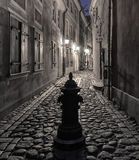 Nocturnal motif with narrow medieval street in old European town Stock Photography