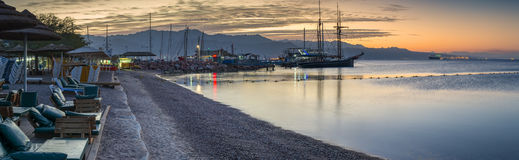 Nocturnal panoramic view on central public beach in Eilat, Israel Royalty Free Stock Images