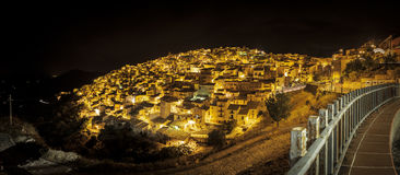 Nocturnal panoramic view of Prizzi, Italy Stock Photos