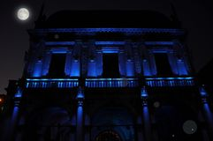Nocturnal renaissance architecture in blue light. Piazza Loggia. Brescia, Italy. Stock Photos