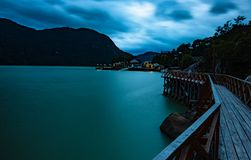 Nocturnal sunset tones of Caleta Torte. Photograph of the night landscape of Caleta Tortel, with its tone and lights on the shores of the Pacific ocean. View royalty free stock photography
