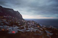 Capri at dusk. Nocturnal view of the island coast of Capri royalty free stock photography