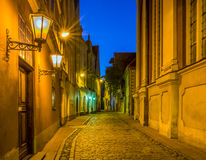 Nocturnal view on medieval street in old Riga city Royalty Free Stock Photo