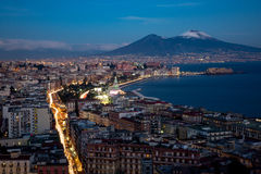 Nocturnal view of Naples with Vesuvius mount Stock Photos