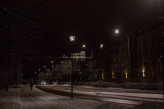 Nocturnal Walk. Night view of the town of Jyvaskyla in the Central Finland. There's already snow in the late October royalty free stock image