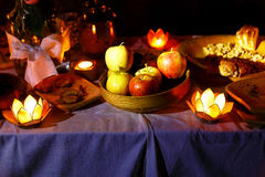 Nocturnal wedding feast held in nature with enchanting lotus shape cande holders. Royalty Free Stock Photo