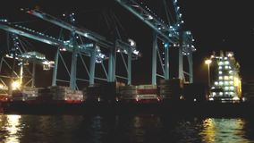 Nocturne footage in Algeciras cargo with containership downloading. Containership of loading and downloading cargo in Algeciras harbor terminal in Algeciras bay stock video