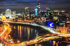 Nocy miasta zamazany tło Zdjęcia Stock