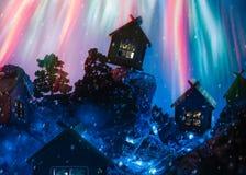 Nocy zimy krajobraz z budami i fajerwerkami obraz stock