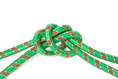 Node. Of the two green ropes on a white background Royalty Free Stock Photo