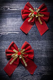Nodi di Natale sul concetto di feste del bordo di legno Fotografia Stock