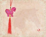 Nodo cinese del cavallo su fondo di carta Immagine Stock Libera da Diritti