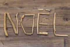 Noel拼写了与漂流木头 免版税库存照片