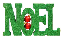 Noel. Written in green glitter with two small red christmas ornaments tucked inside, isolated on white Royalty Free Stock Photos