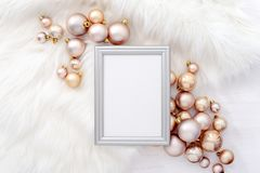 Noel or Christmas background. Noel or Christmas feminine social media background with a space for a text in a frame lying down on a white faux fur, decorated stock image