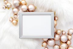 Noel or Christmas background. Noel or Christmas feminine social media background with a space for a text in a frame lying down on a white faux fur, decorated stock photos