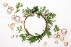 Noel or Christmas background. With handmade Xmas wreath and plain golden balls, view from above, space for a text stock photo