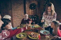 Noel evening, night family gathering, meeting. Cheerful grey-hai stock images