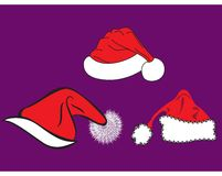 Noel hats. In three different shape and textures Stock Image