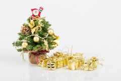 Noel tree and gifts. Small gift boxes under noel tree Stock Images