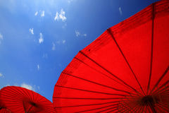Noerthern Thailand traditional red parasols with clear blue sky stock photos