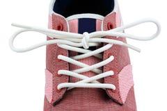 Noeud de dentelle d'une chaussure de toile Image libre de droits