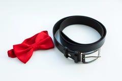 Noeud papillon et ceinture Photographie stock