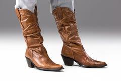 Nogi w cajgach i kowbojów butach Fotografia Stock