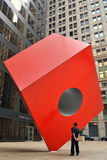Noguchi's Red Cube. Noguchi's Cube at the HSBC Building in the Financial District of New York City Royalty Free Stock Photos