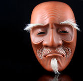 Noh Mask. Traditional Japanese Noh mask against black background royalty free stock images