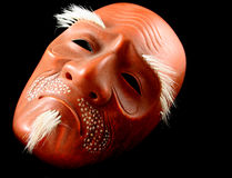 Noh Mask. Traditional Japanese Noh mask against black background royalty free stock photo