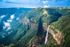 Nohkalikai Falls is the tallest plunge waterfall in India. Its height is 1115 feet 340 metres. The waterfall is located near Cherrapunji, one of the wettest royalty free stock photography