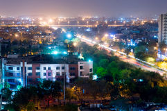 Noida cityscape at night with light trails on road Stock Photography