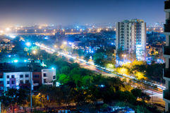 Noida cityscape at night with light trails on road Stock Photo