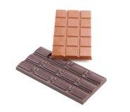 Noir et barre de chocolat au lait. photographie stock