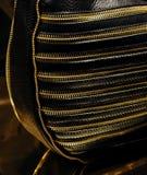 Noir et bourse en cuir d'or Photos libres de droits