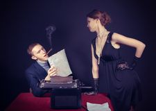 Noir  film journalist and the girl at work Stock Photography
