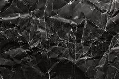 Noircissez le fond de papier chiffonné, texture de papier chiffonnée noire Photographie stock