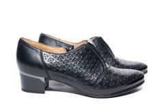 Noircissez les chaussures femelles images stock