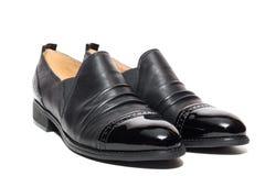Noircissez les chaussures femelles image stock