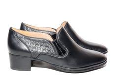 Noircissez les chaussures femelles photos stock