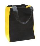 Noircissez n'importe quel sac jaune d'eco de coton Photographie stock libre de droits