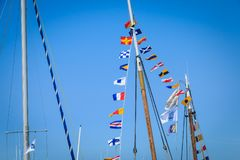 Set of pennants on the mast of a boat. NOIRMOUTIER, FRANCE - August 15, 2016 : set of pennants on the mast of a boat that float in the air on a summer day Stock Photos