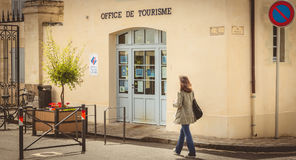 Woman walks in front of the tourist information office in downto Stock Photos