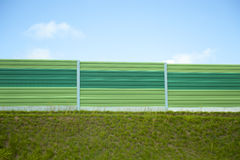 Noise barrier. A modern green noise barrier royalty free stock photography