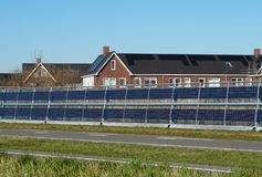 Noise barrier with integrated solar panels stock photography